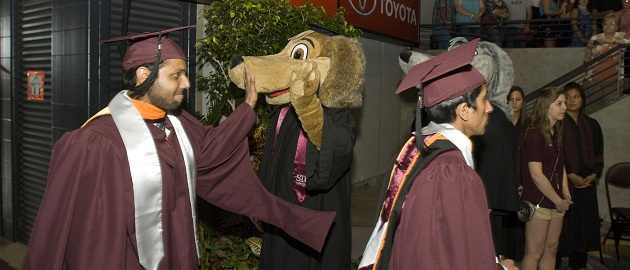 Students and Saluki Mascot at Graduation